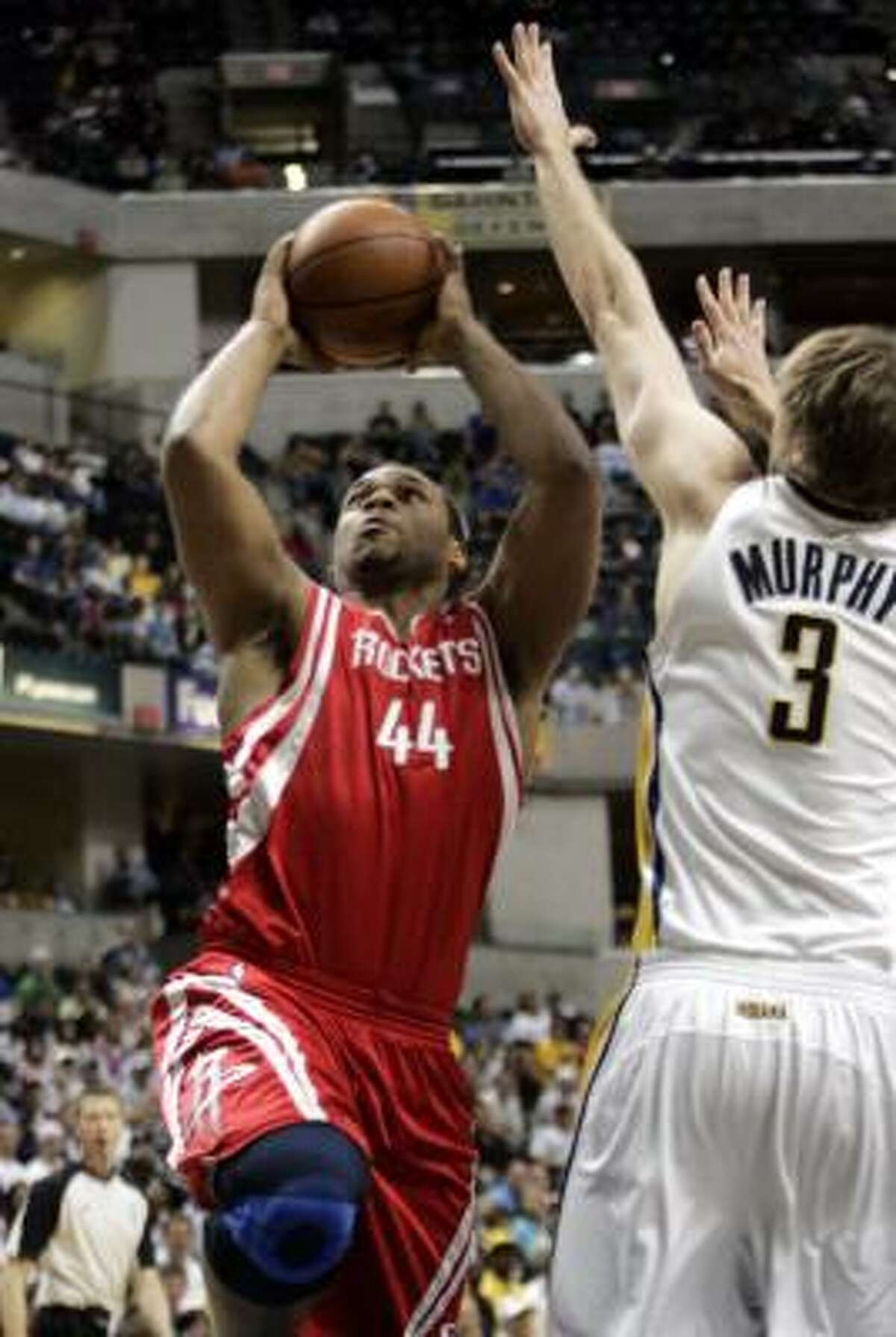 Rockets' Chuck Hayes puts up a shot as Pacers' Troy Murphy defends.
