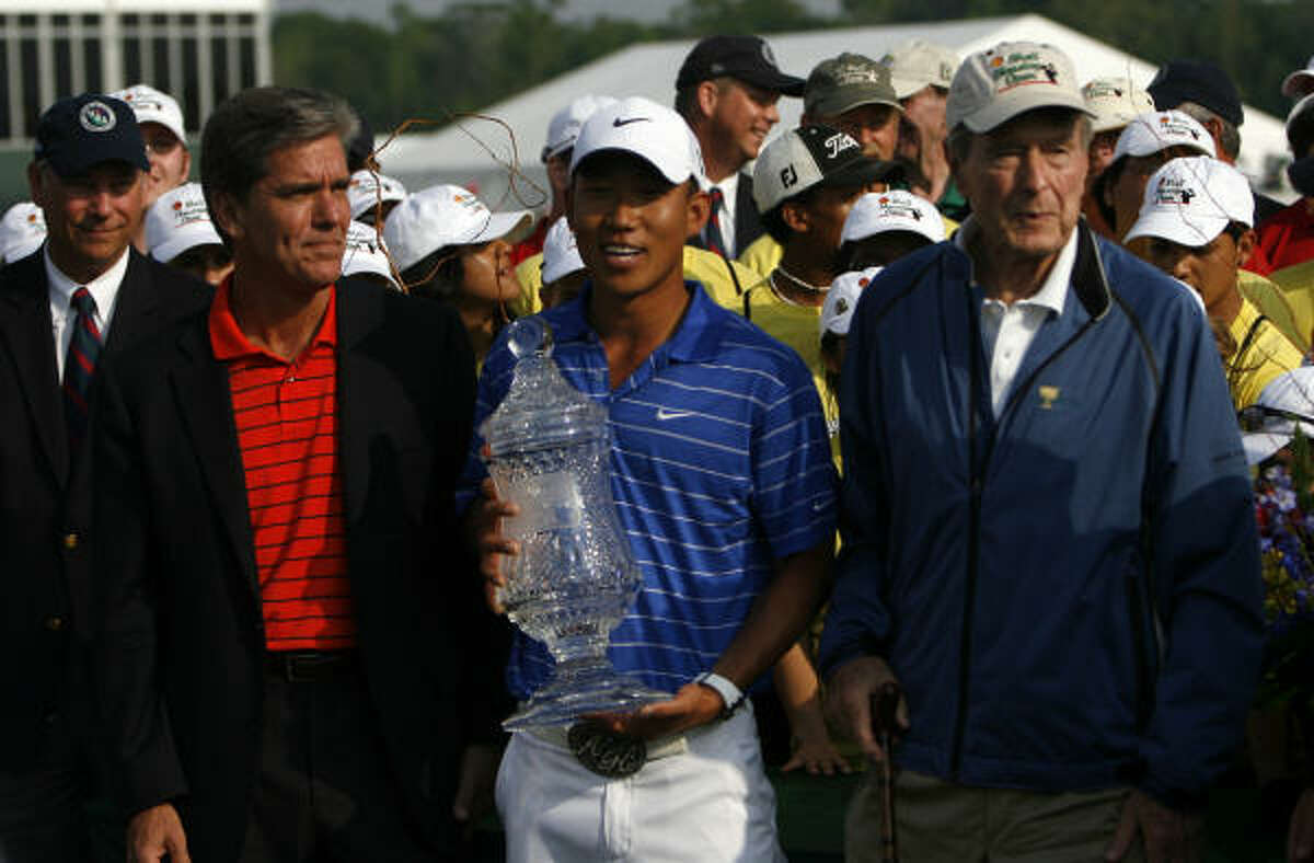 Anthony Kim holds the Shell Houston Open golf tournament trophy at Redstone Golf Club.