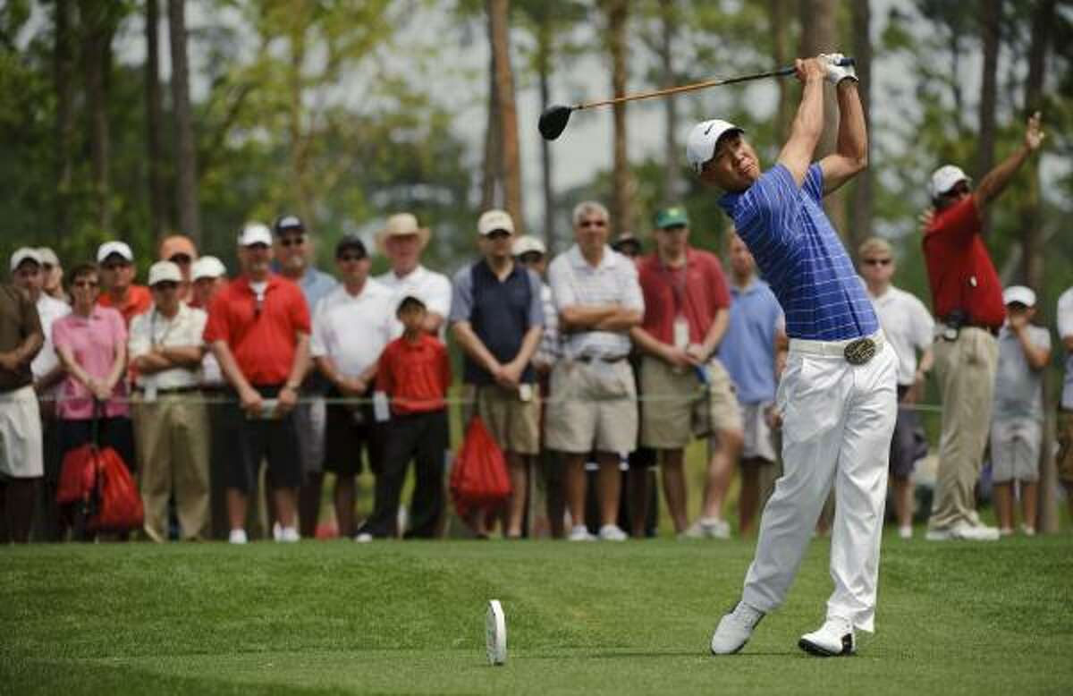 Anthony Kim tees of on the fourth hole during the final round of the Shell Houston Open.