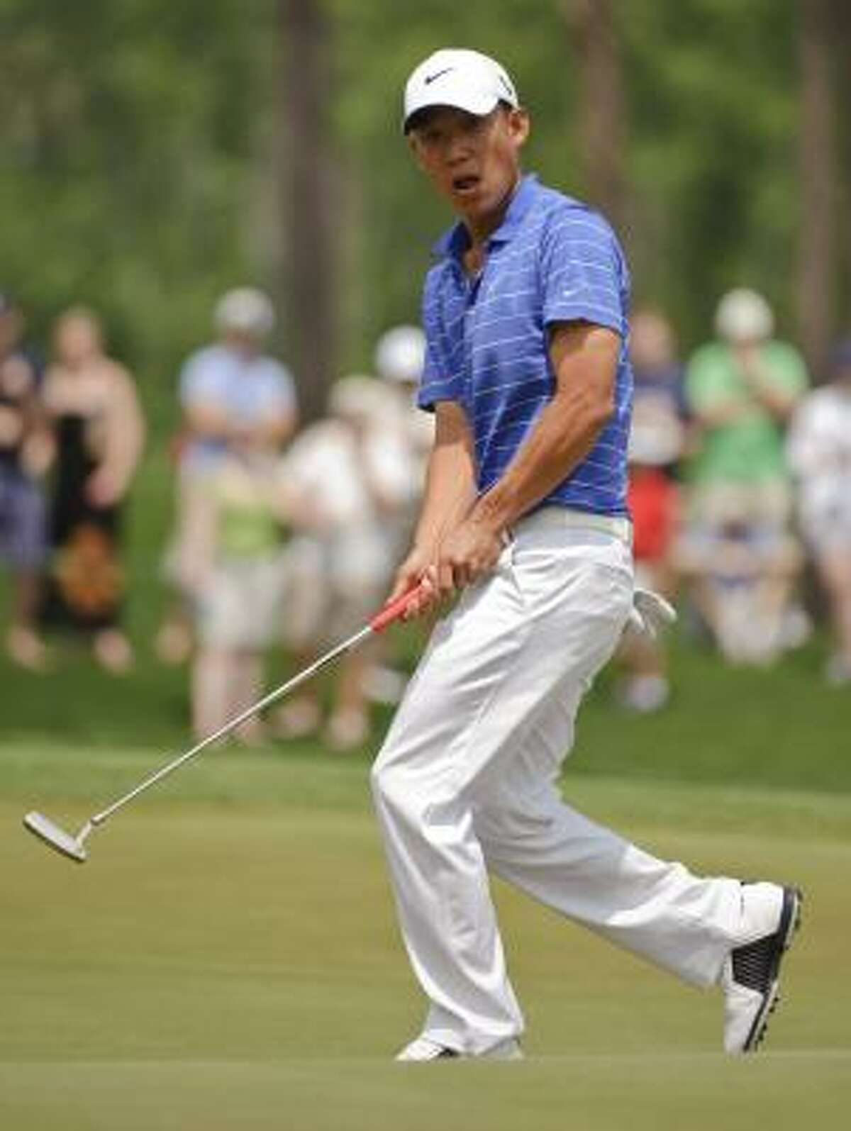 Anthony Kim reacts after missing a birdie putt on the third hole.