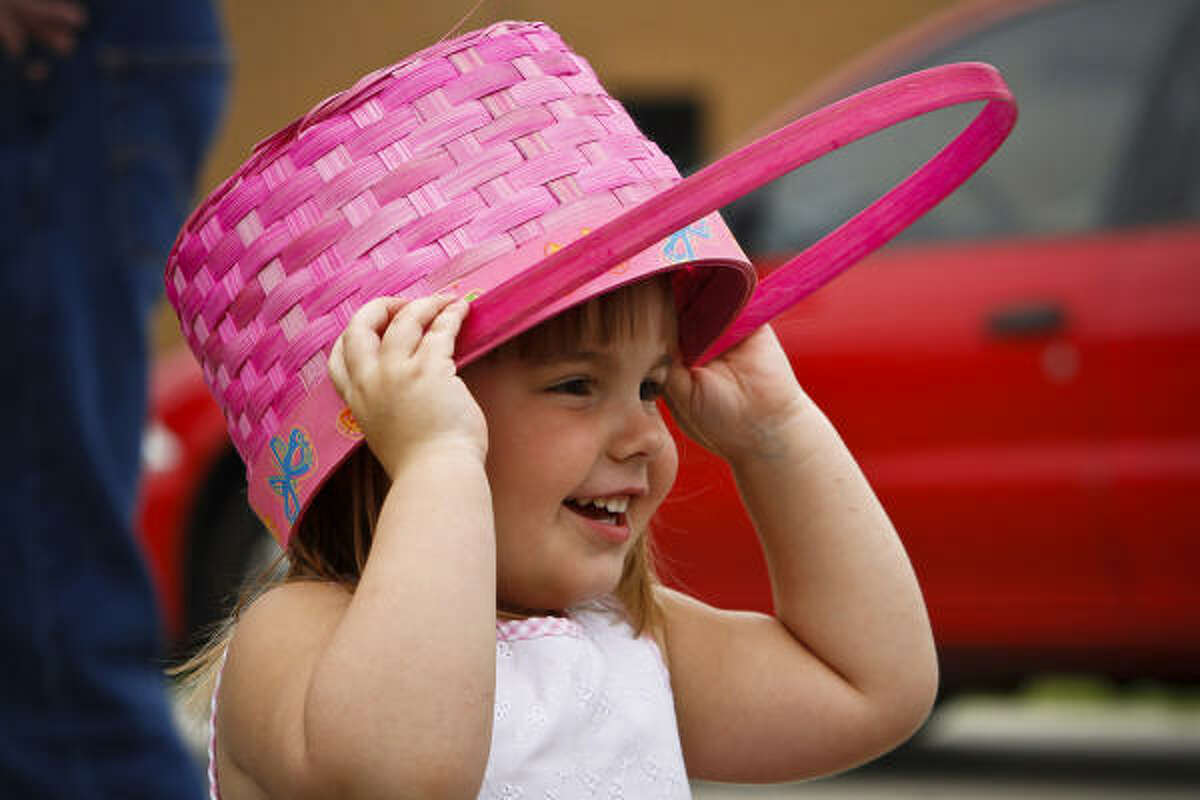 Ava Grace Dew, 3, waits at the Woodlands Christian Center before 5,000 eggs were dropped from a helicopter for the Easter Day celebration egg hunt Sunday, April 4, 2010, in Spring.