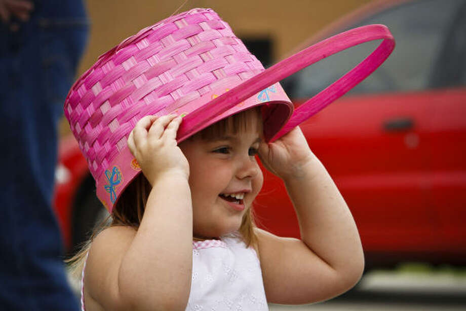Ava Grace Dew, 3, waits at the Woodlands Christian Center before 5,000 eggs were dropped from a helicopter for the Easter Day celebration egg hunt Sunday, April 4, 2010, in Spring. Photo: Michael Paulsen, Chronicle