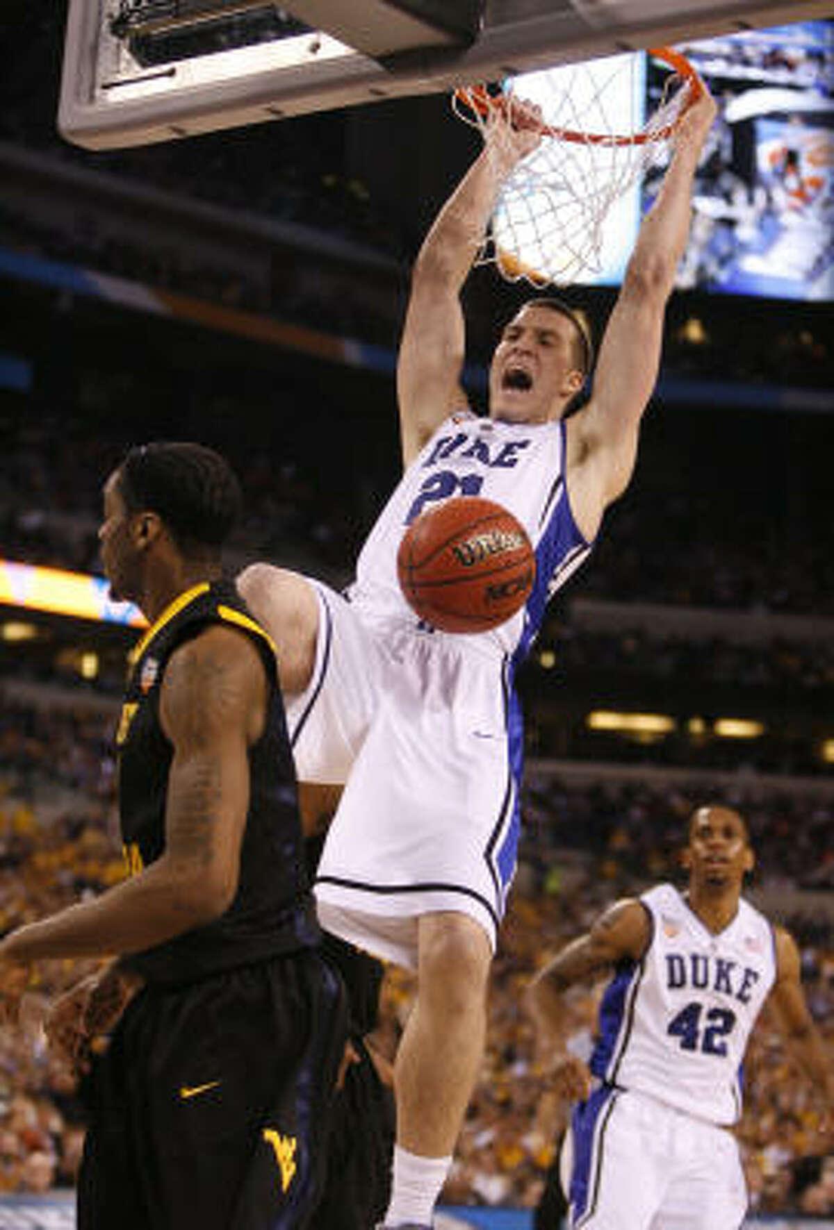 Duke forward Miles Plumlee powers home a dunk.