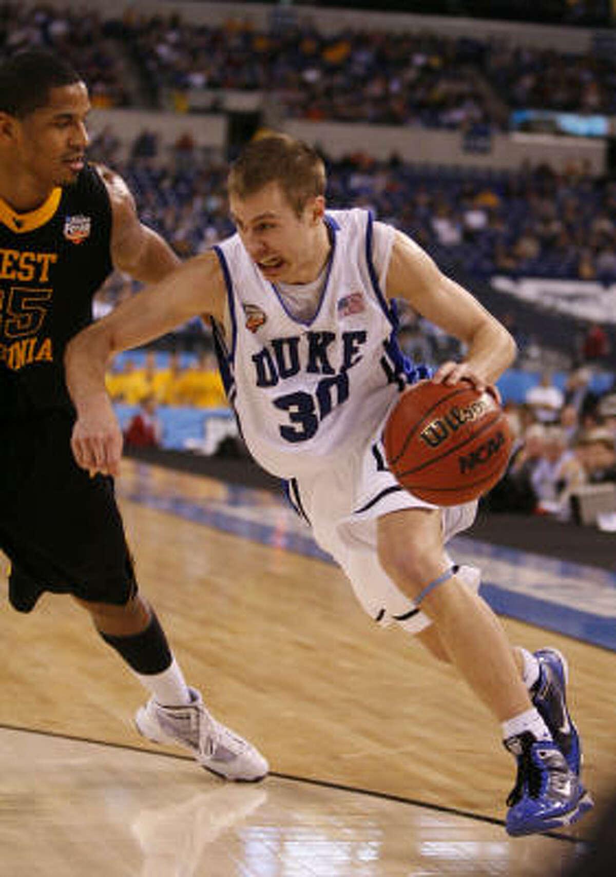 Duke guard Jon Scheyer drives around West Virginia forward Wellington Smith during the second half.