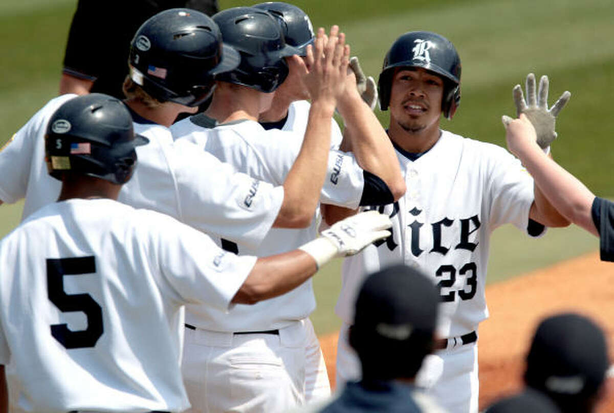 Rice's Anthony Rendon celebrates his grand slam with teammates in the first inning.