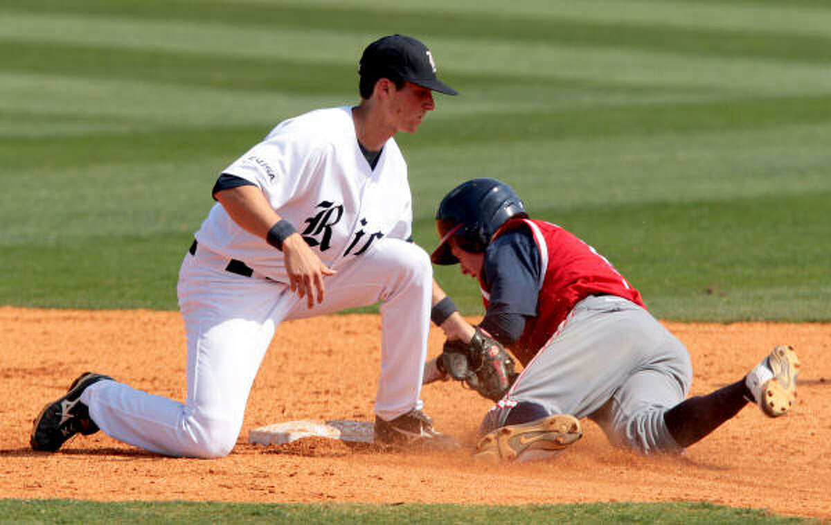 Rice shortstop Rick Hague tags out UH's Blake Kelso as Kelso attempted to steal second.