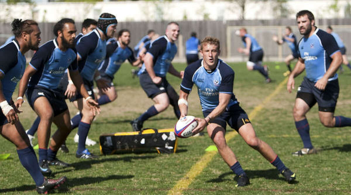 Katy's Hunter Leyland, center, works out with the U.S. Men's National Rugby Team during training camp at Strake Jesuit High School.