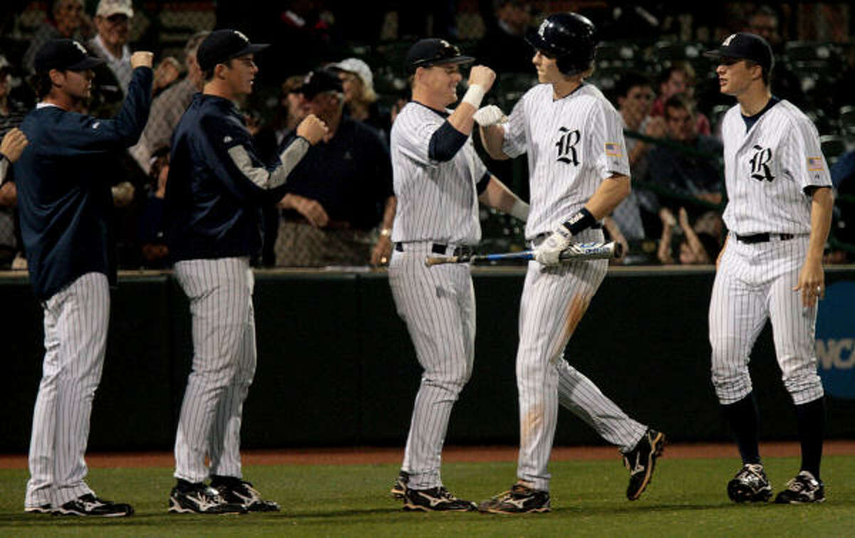 Rice's Jeremy Rathjen, second from right, celebrates with teammates after hitting a two-run home run of UH reliever Mo Wiley in the fifth inning of Friday's game. Rice won 11-2 to clinch the Silver Glove Series.