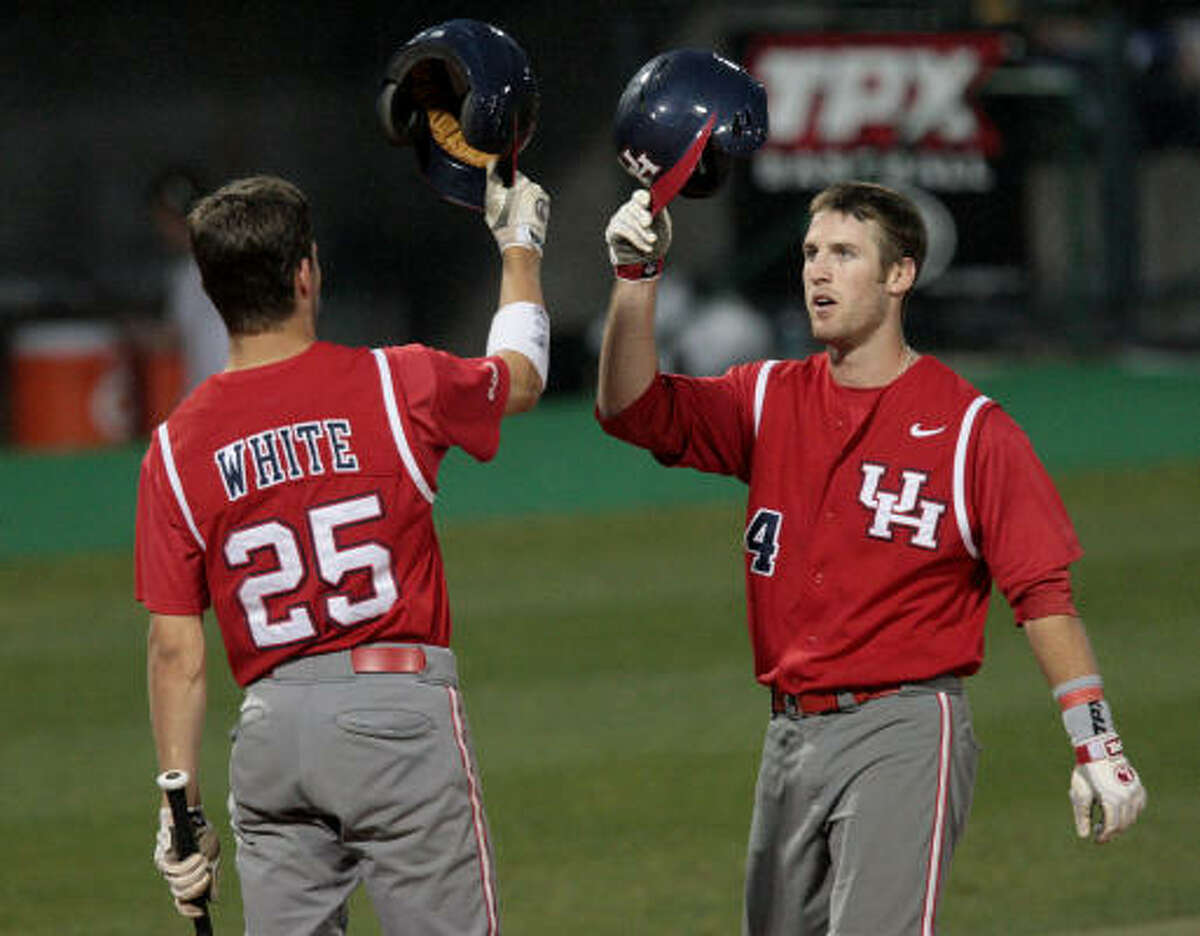 UH's Joel Ansley, right, celebrates with Taylor White after hitting a solo home run in the fourth inning.