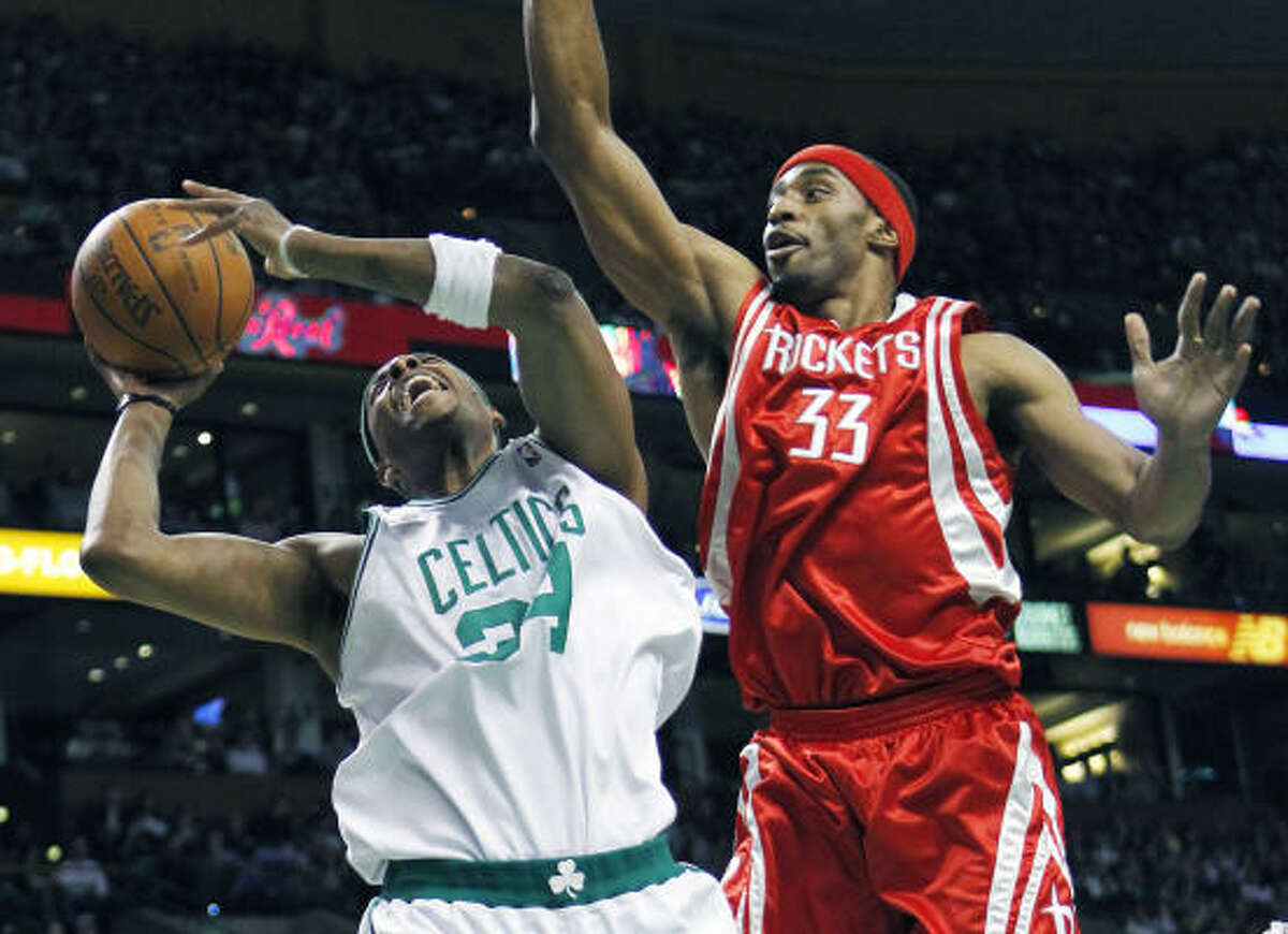 Rockets forward Mike Harris (33) fouls Boston's Paul Pierce in the second quarter of Friday's game in Boston. The Rockets won 119-114 in overtime.