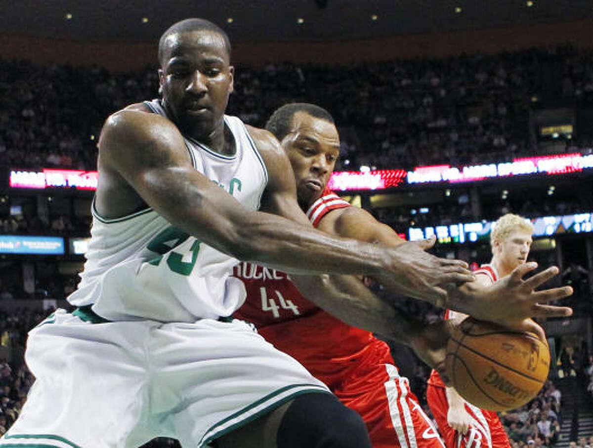 Rockets center Chuck Hayes, right, battles Boston's Kendrick Perkins for a loose ball in the first quarter.