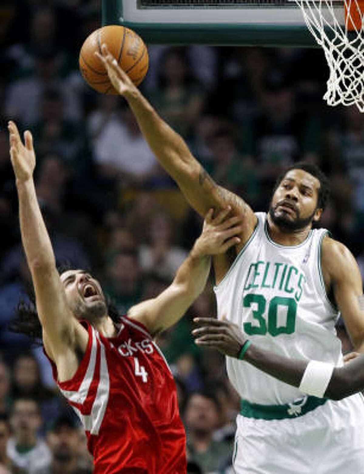 Celtics forward Rasheed Wallace fouls Rockets forward Luis Scola.
