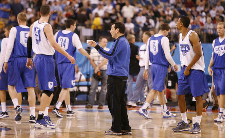Duke coach Mike Krzyzewski leads his team through Friday's practice at Lucas Oil Stadium in Indianapolis. The Blue Devils will face West Virginia in a Final Four matchup Saturday. Photo: Karen Warren, Chronicle