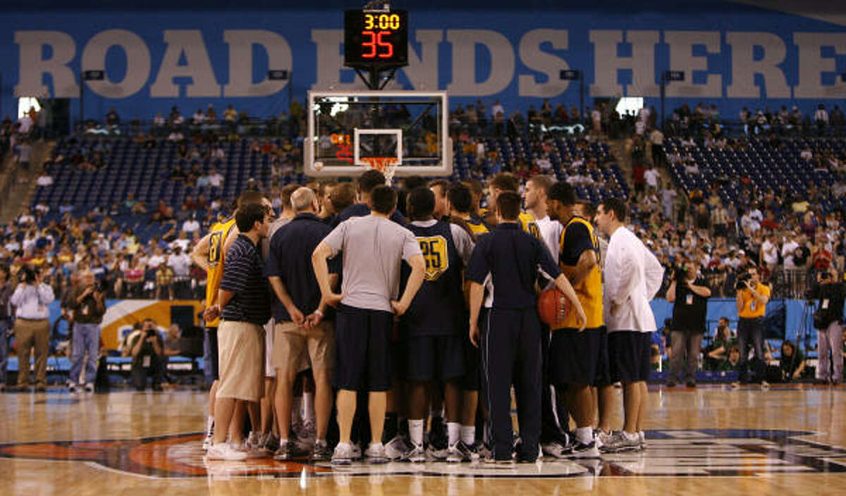 West Virginia huddles after its practice.