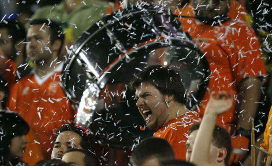 Dynamo fans celebrate in the final seconds of the Dynamo's home opener against Real Salt Lake at Robertson Stadium. Photo: Billy Smith II, Chronicle