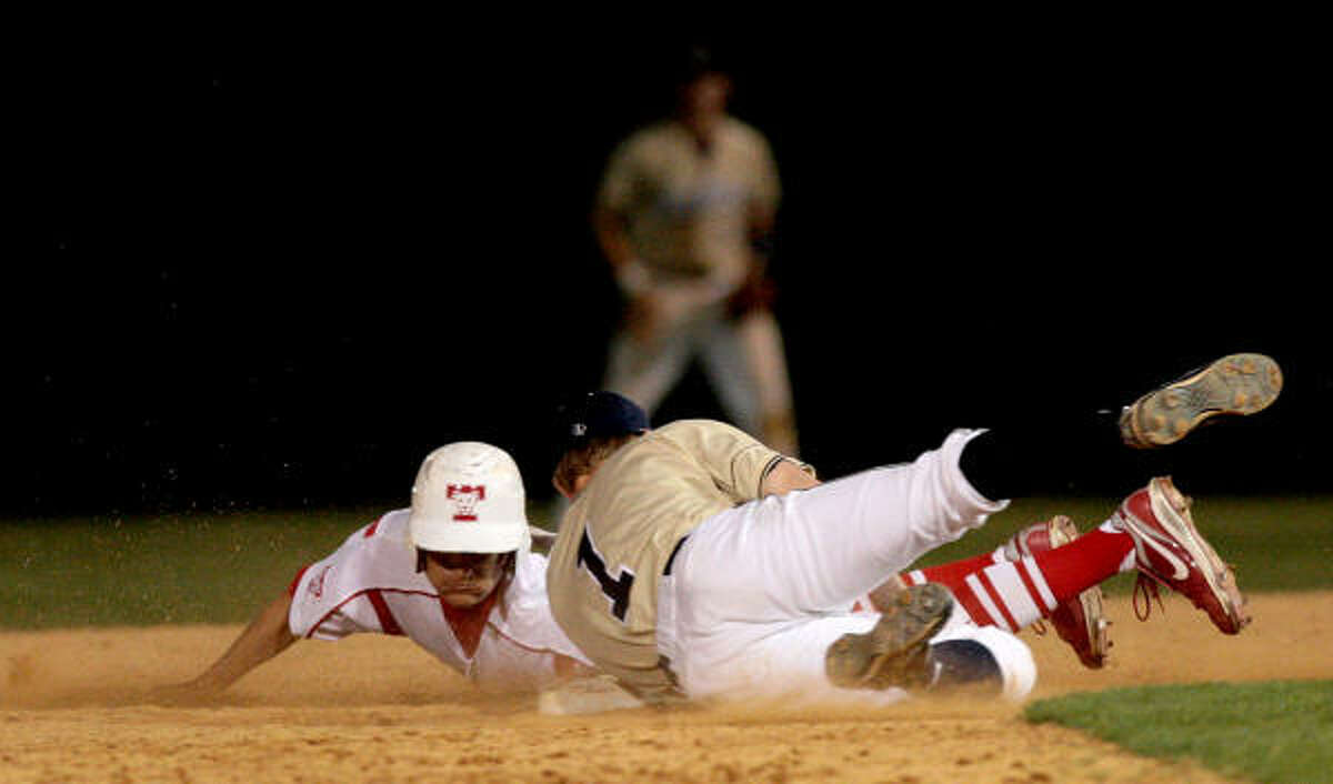 Klein Collins second baseman Ron Reemts (1) tags out Tomball's Dustin Cole in the fifth inning.