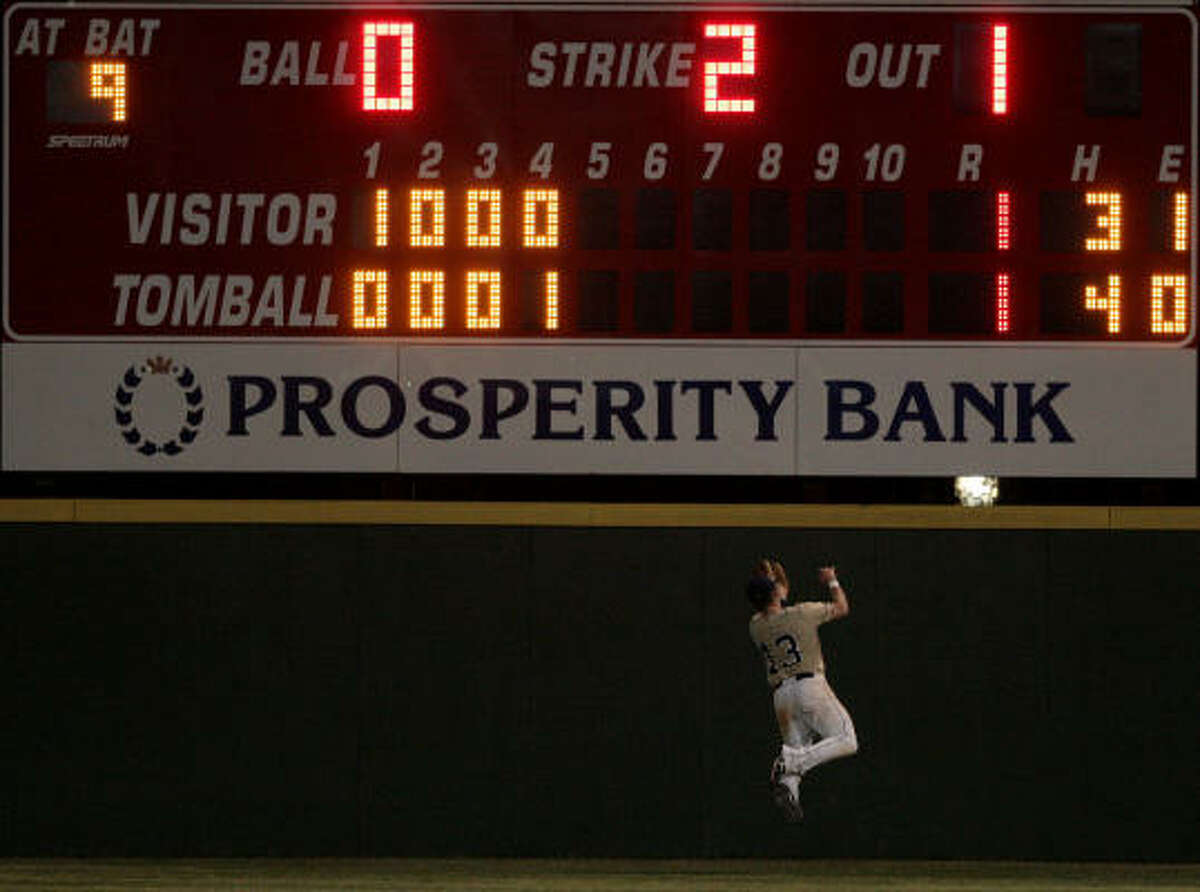 Klein Collins' Jason Zitzmann makes a over the shoulder catch in the fifth inning against Tomball.
