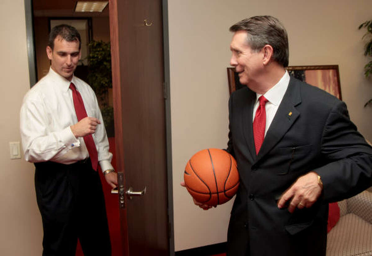 Newly-appointed University of Houston men's basketball coach James Dickey talks with athletic director Mack Rhoades.