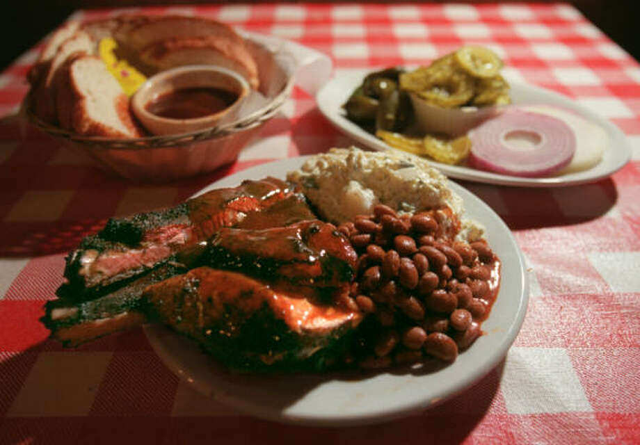 Swinging Doorat 3714 FM 359 Try the meat combo plate of ribs and chicken with beans and potato salad, bread basket and a relish dish. Swinging Door Combo plates include two meats and two sides. Photo: Kevin Fujii, Houston Chronicle