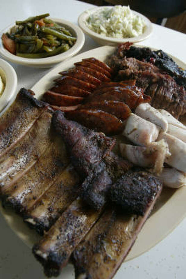 Pizzitola's Bar-B-Cue At 1703 Shepherd Drive, they take their meats - and side dishes - seriously.  The barbecue platter includes spareribs, sausage, brisket and deboned chicken ribs, with side dishes of green beans and coleslaw. Photo: Karen Warren, HOUSTON CHRONICLE