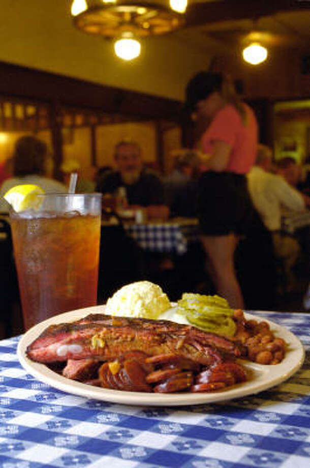 Brothers-In-Law's Bar-B-Que Must taste the barbecue plate with links and ribs at 503 Freeport St. A barbecue plate is piled with ribs, sliced link sausage, potato salad and beans. Photo: John Everett, Houston Chronicle