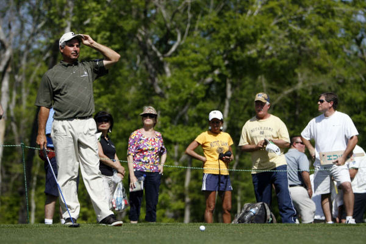 University of Houston graduate, Fred Couples, prepares to tee off on the 10th hole as fans watch during the Shell Houston Open Grand Pro-Am.
