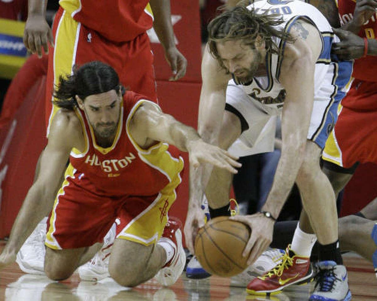 Wizards forward Fabricio Oberto, right, and Rockets forward Luis Scola scramble for the ball.