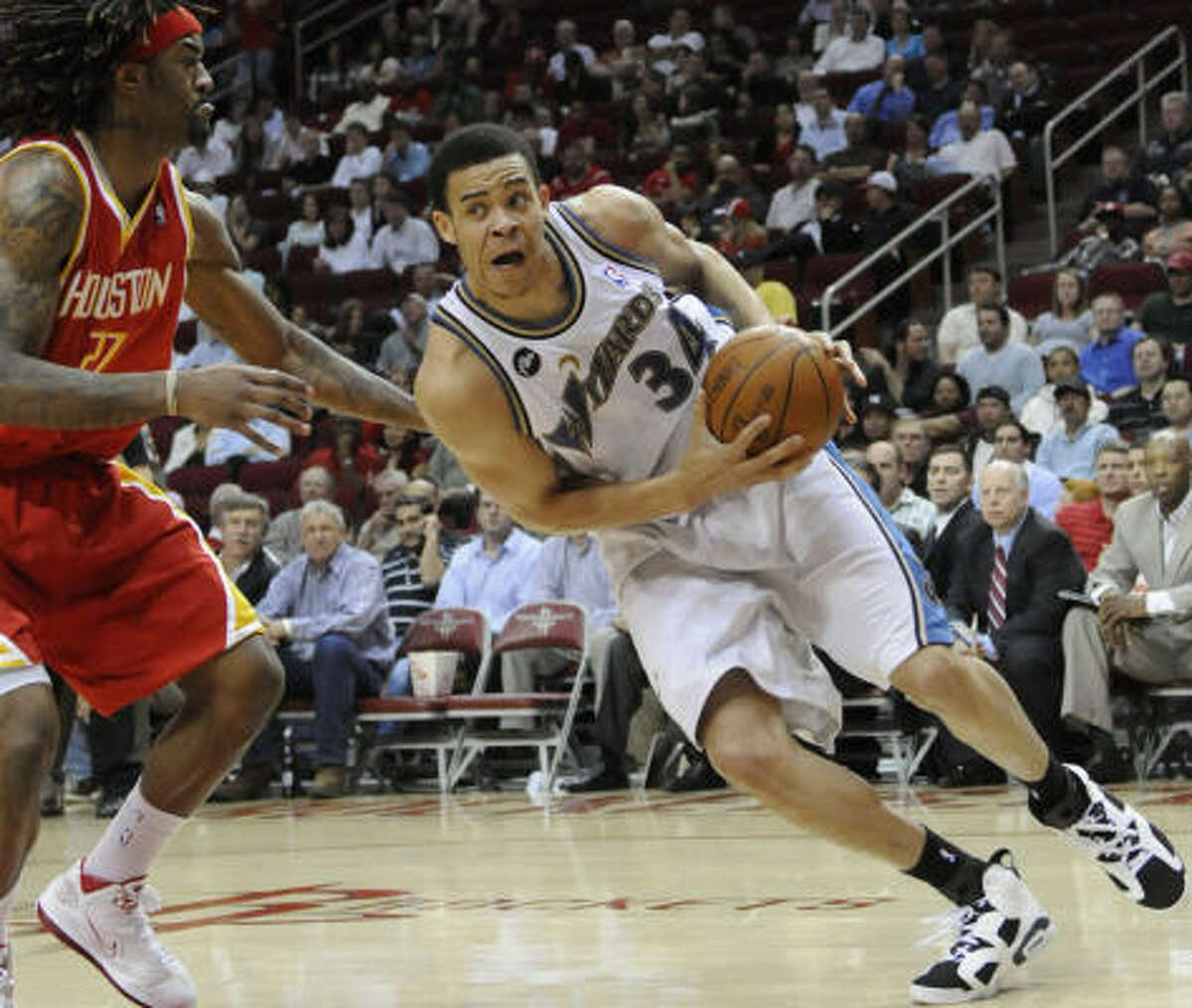 Wizards forward JaVale McGee drives the ball past Rockets forward Jordan Hill during the first half.