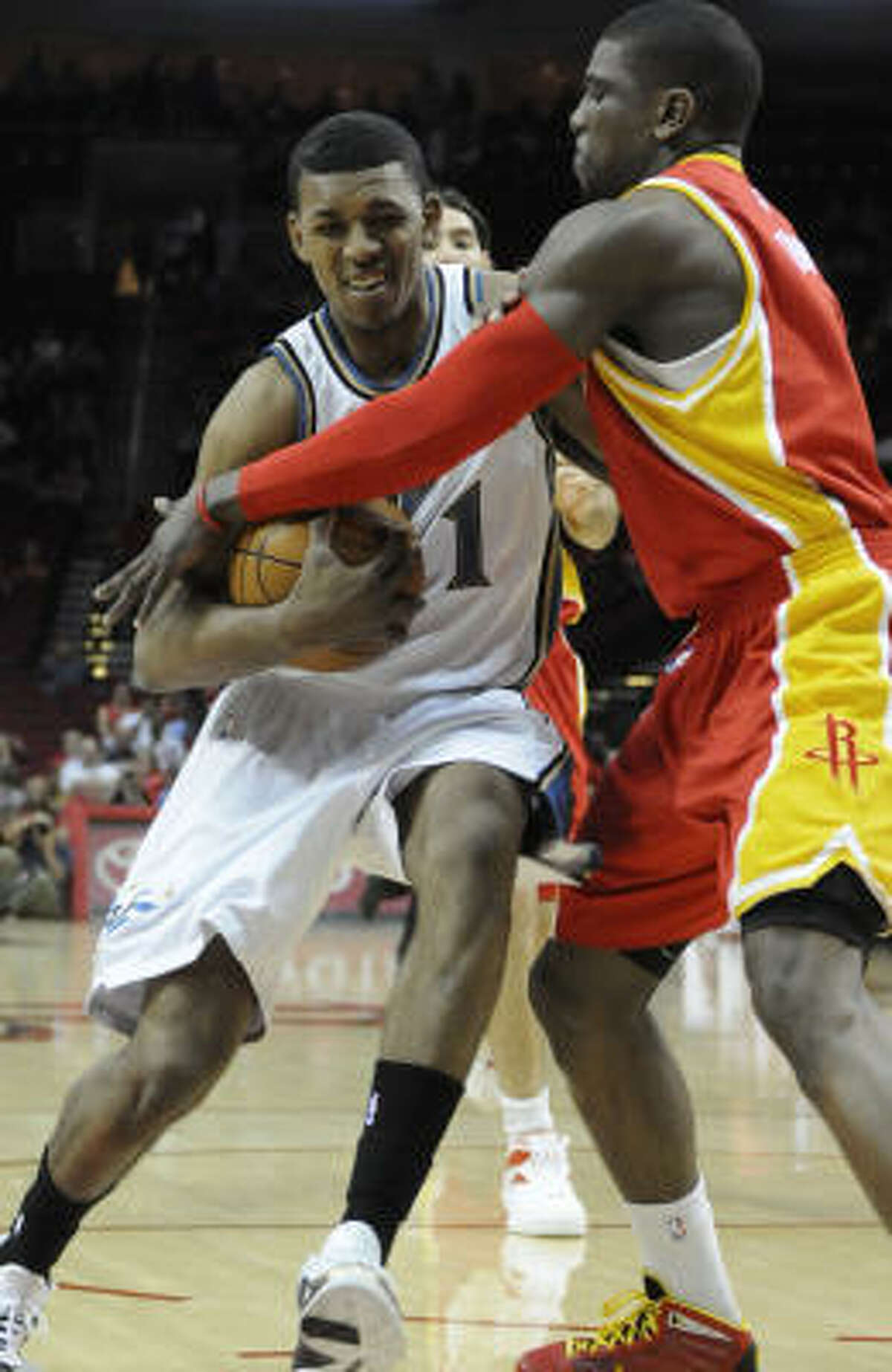 Wizards guard Nick Young goes for the basket while defended by Rockets guard Jermaine Taylor.