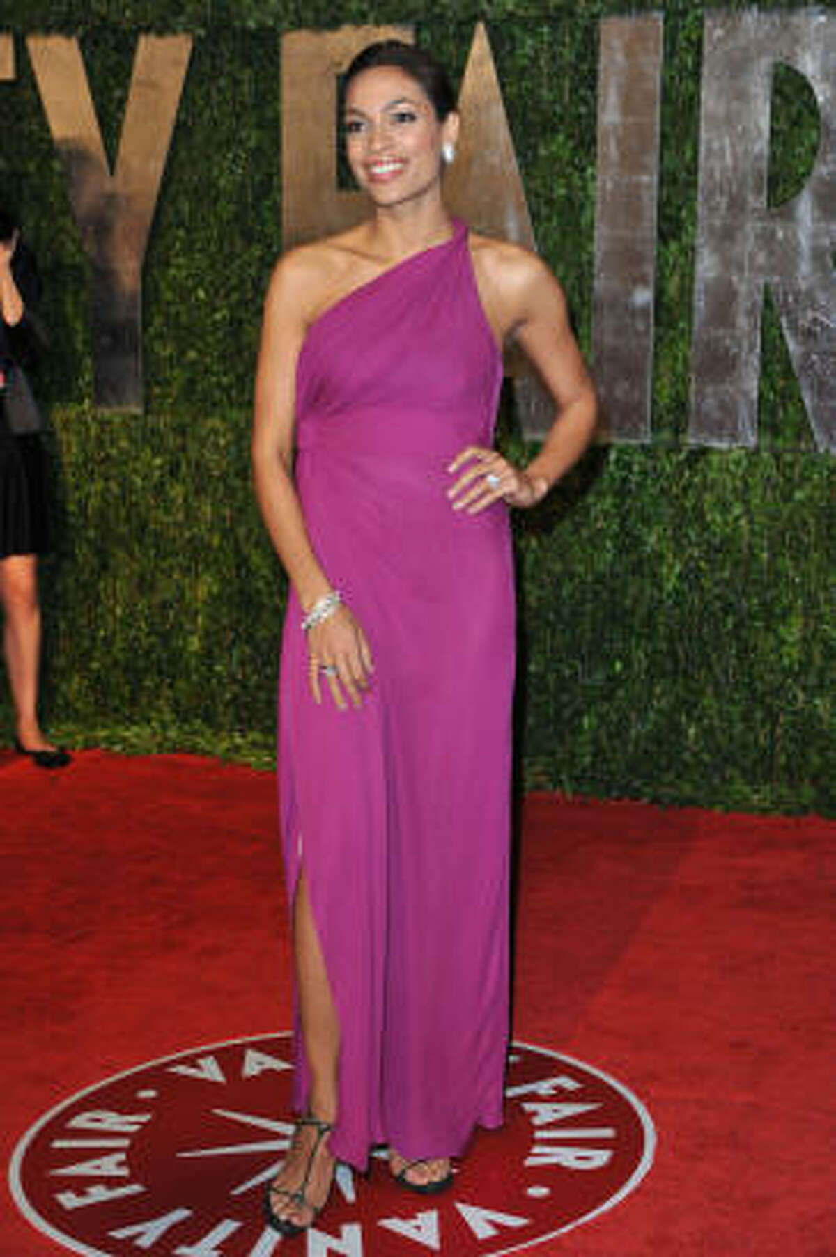 Rosario Dawson's beautiful complexion works perfectly with this bright pink Greek goddess inspired gown.