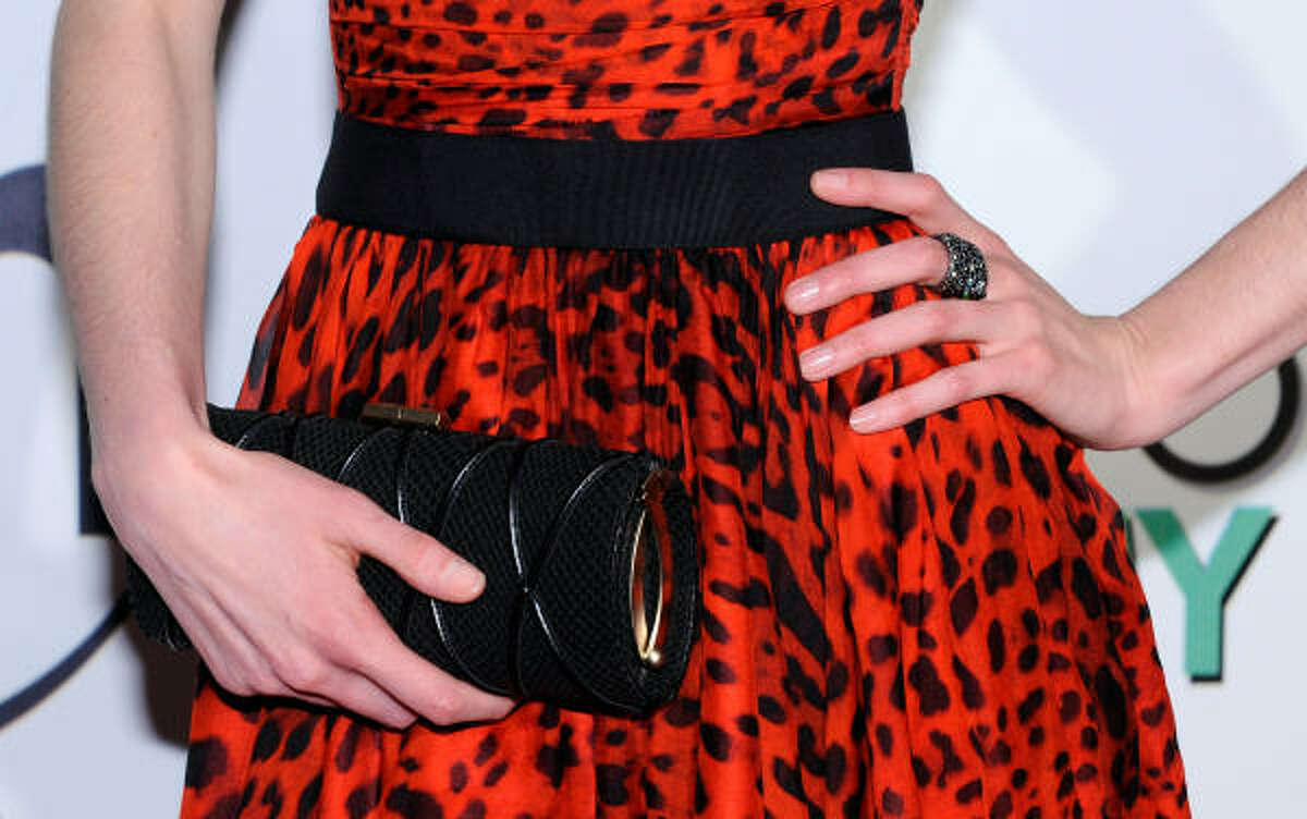 If your dress makes a statement, go with a clutch that is simple and chic so your outfit isn't overwhelming.