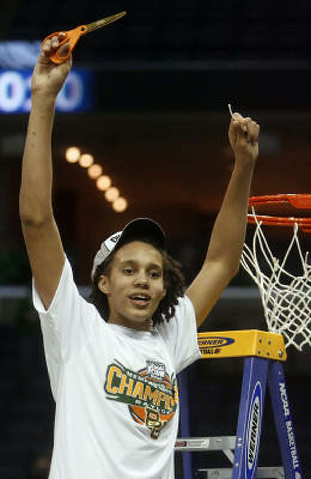 Baylor's Brittney Griner cuts off a piece of the net after Baylor beat Duke 51-48.