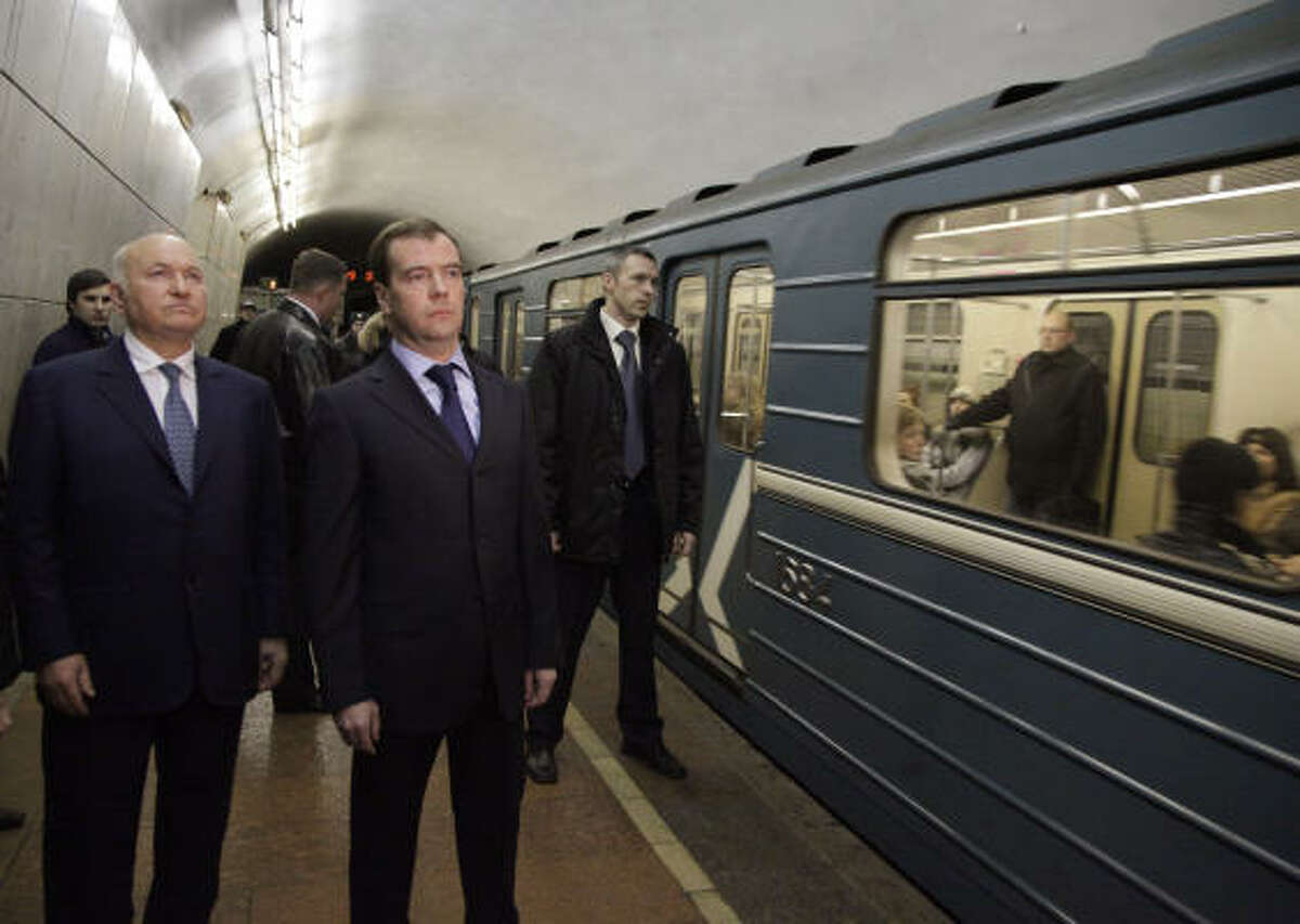 Russian President Dmitry Medvedev and the Mayor of Moscow Yuri Luzhkov hold a minute of silence in memory of the victims of the blast at the Lubyanka metro station in Moscow.