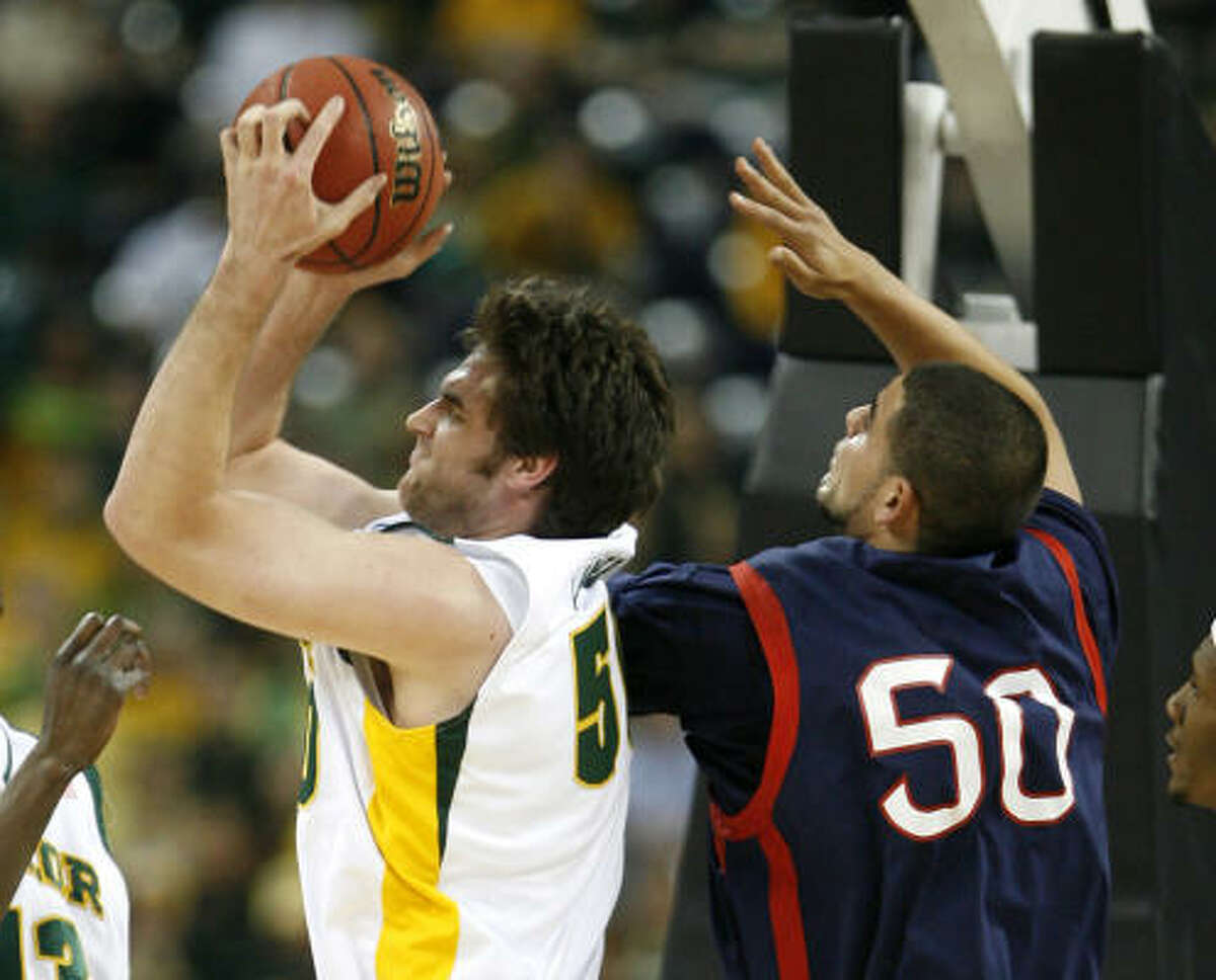 March 26: No. 3 Baylor 72, No. 10 Saint Mary's 49 Baylor center Josh Lomers grabs a rebound away from Saint Mary's center Omar Samhan during the first half of Friday's game.