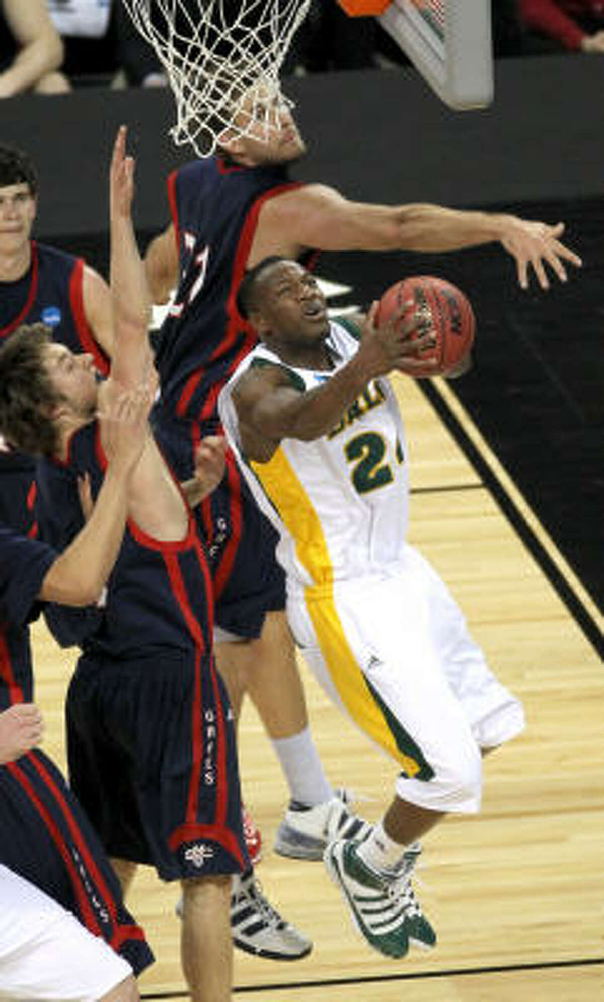 Baylor guard LaceDarius Dunn goes under the basket for a reverse layup.