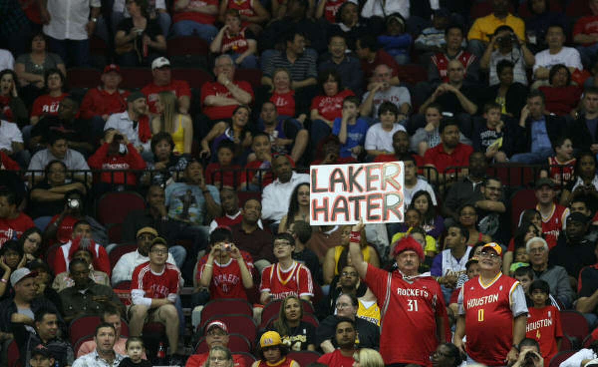 A couple of Rockets fans showcase their hatred of the Lakers with this sign.