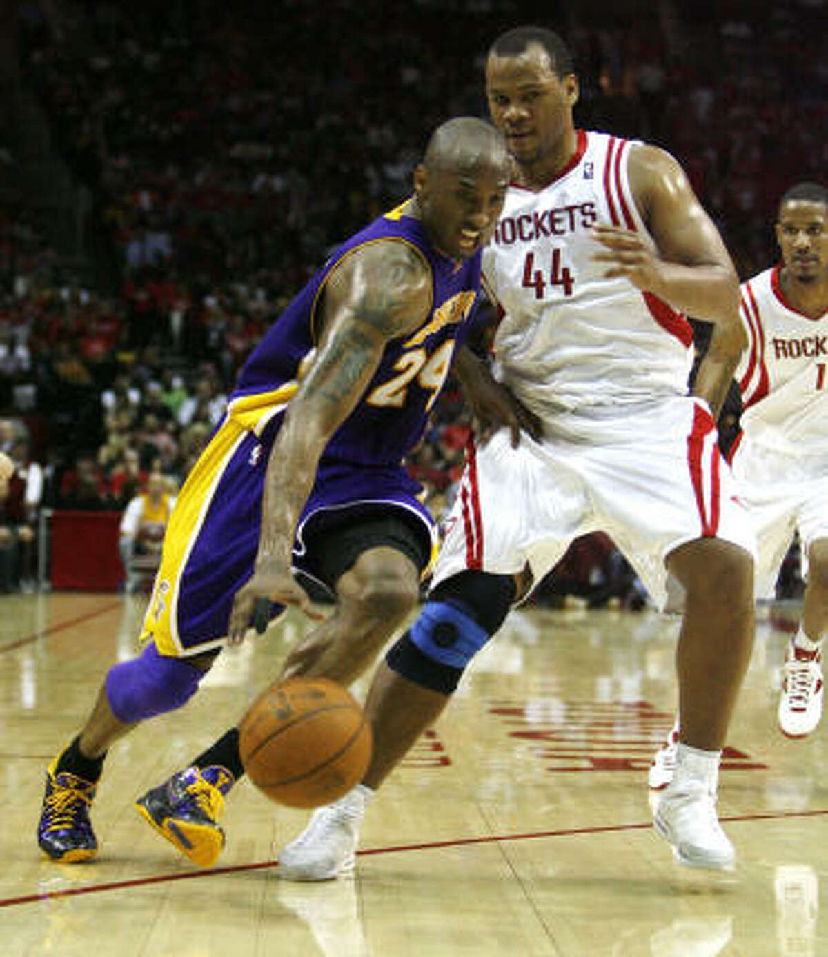 Chuck Hayes, right, and the Rockets had a tough time containing Los Angeles guard Kobe Bryant, who had 17 points, 10 rebounds and nine assists in the Lakers' 109-101 victory Saturday night at Toyota Center.