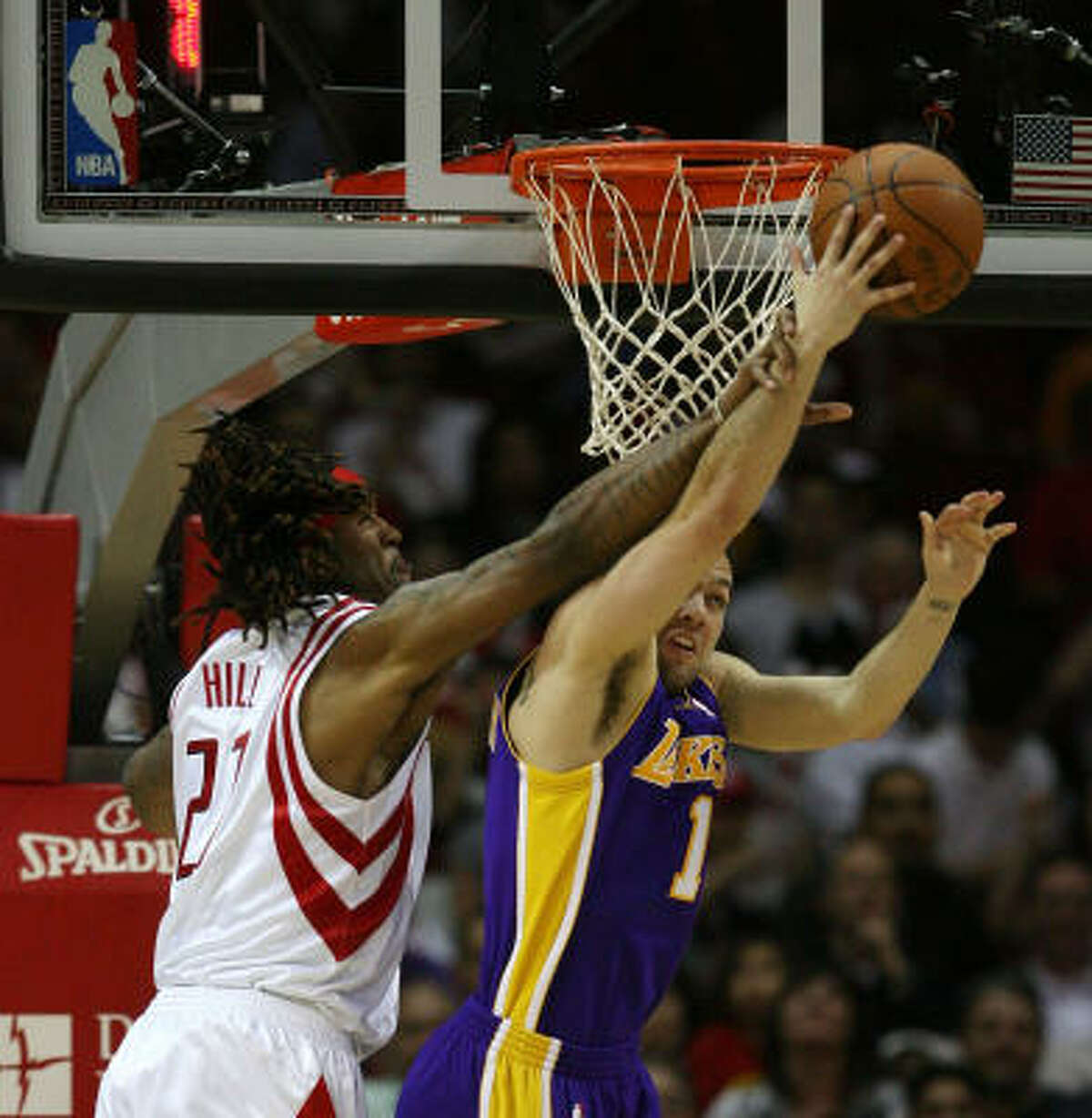 Los Angeles guard Jordan Farmar, right, is fouled by Rockets forward Jordan Hill as he goes to the rim in the second half.