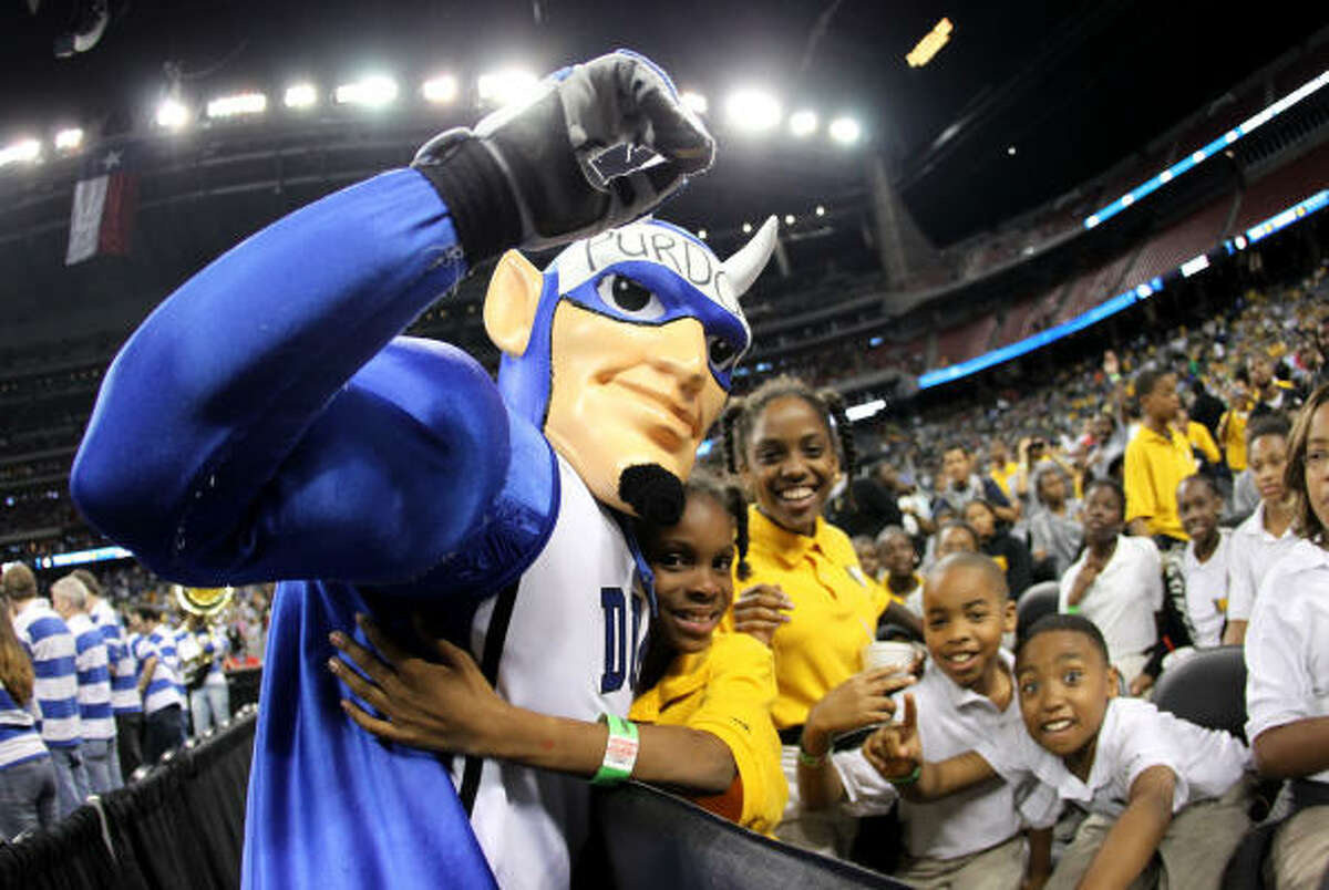 The Duke mascot hugs fans before the start of the Duke-Purdue game.