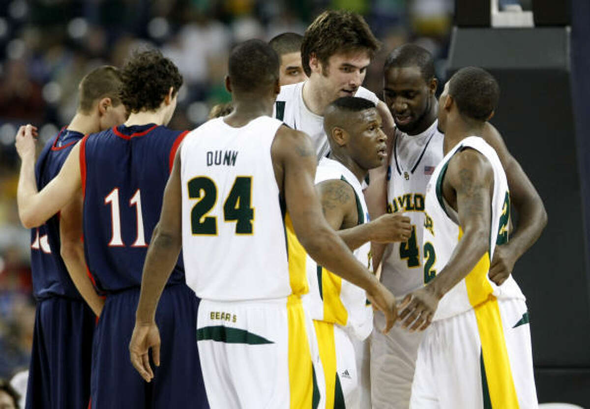 Team Baylor huddles during the first half of the game against Saint Mary's.