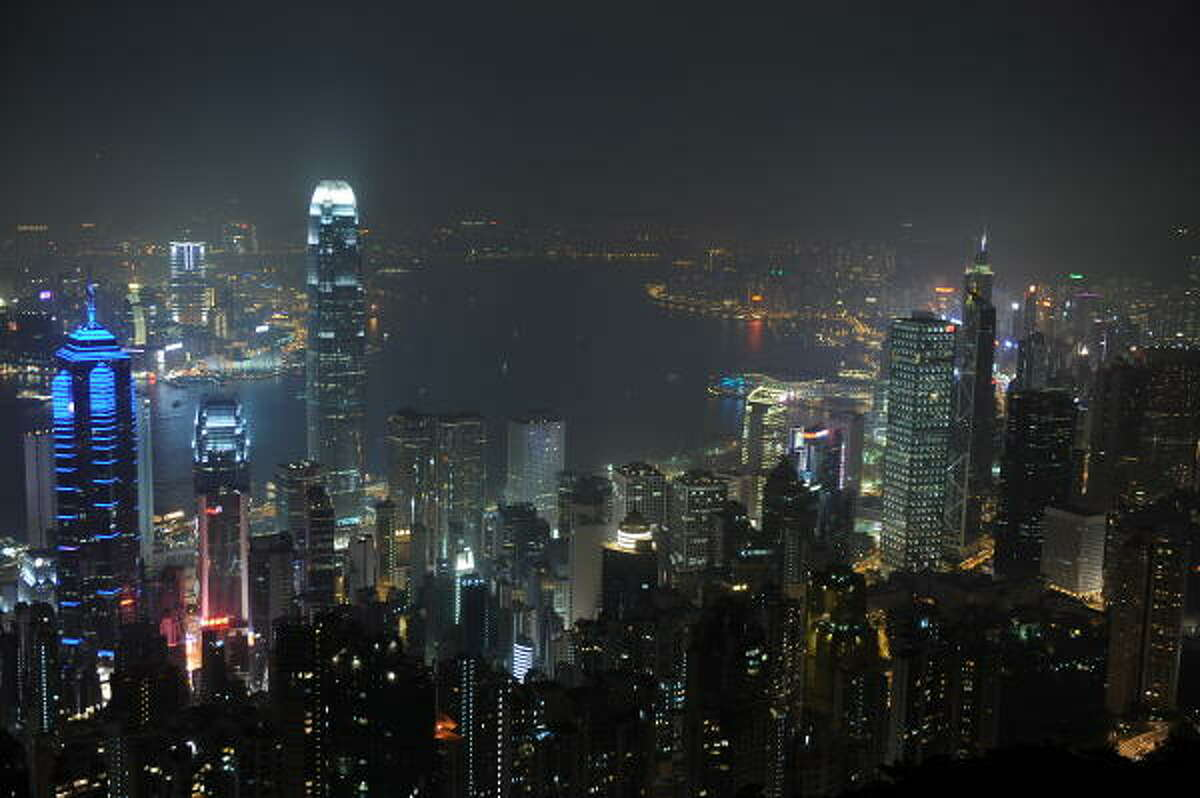 The skyline of Hong Kong Island and Kowloon is seen shortly before the lights were switched off for Earth Hour in Hong Kong on March 27, 2010.
