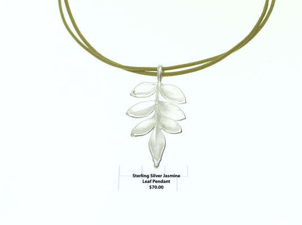 A silver coated leaf necklace.