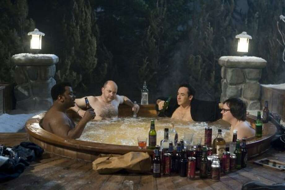 Critic Amy Biancolli describes the time-travelers in Hot Tub Time Machine as Nick (Craig Robinson), a whipped family man who longs for his glory days as a cover-band frontman; Lou (Rob Corddry), a misanthropic, alcoholic, nihilistic, misogynistic, foul-mouthed pig determined to take advantage of the 1980s' party-hearty atmosphere; Adam (John Cusack), a sad-sack insurance salesman; and his nephew Jacob (Clark Duke), a computer-addicted goober. Photo: Associated Press