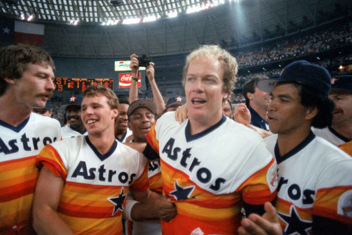 Astros Danny Darwin, from left, Bill Doran, Mike Scott and Jose Cruz celebrate Scott's no-hitter in the Astrodome on Sept. 25, 1986. The win sent the Astros to the National League Championship Series to face the New York Mets for a shot at the World Series.
