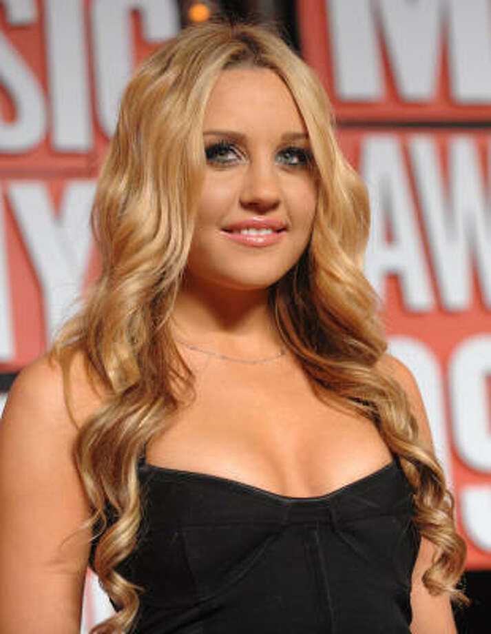 Someone must have broken into Amanda Bynes' house in the middle of the night and forcefully pierced her face. That's the only explanation we can come up with for this photo, which she posted on her Twitter feed. Follow me on Tumblr amandabynes1986.tumblr.com Photo: Peter Kramer, Associated Press