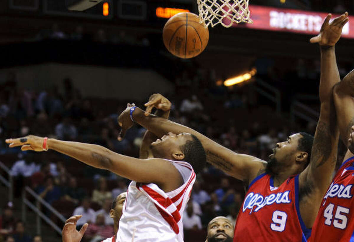 Rockets' Kyle Lowry, left, is fouled by Clippers' DeAndre Jordan (9) during the first quarter.