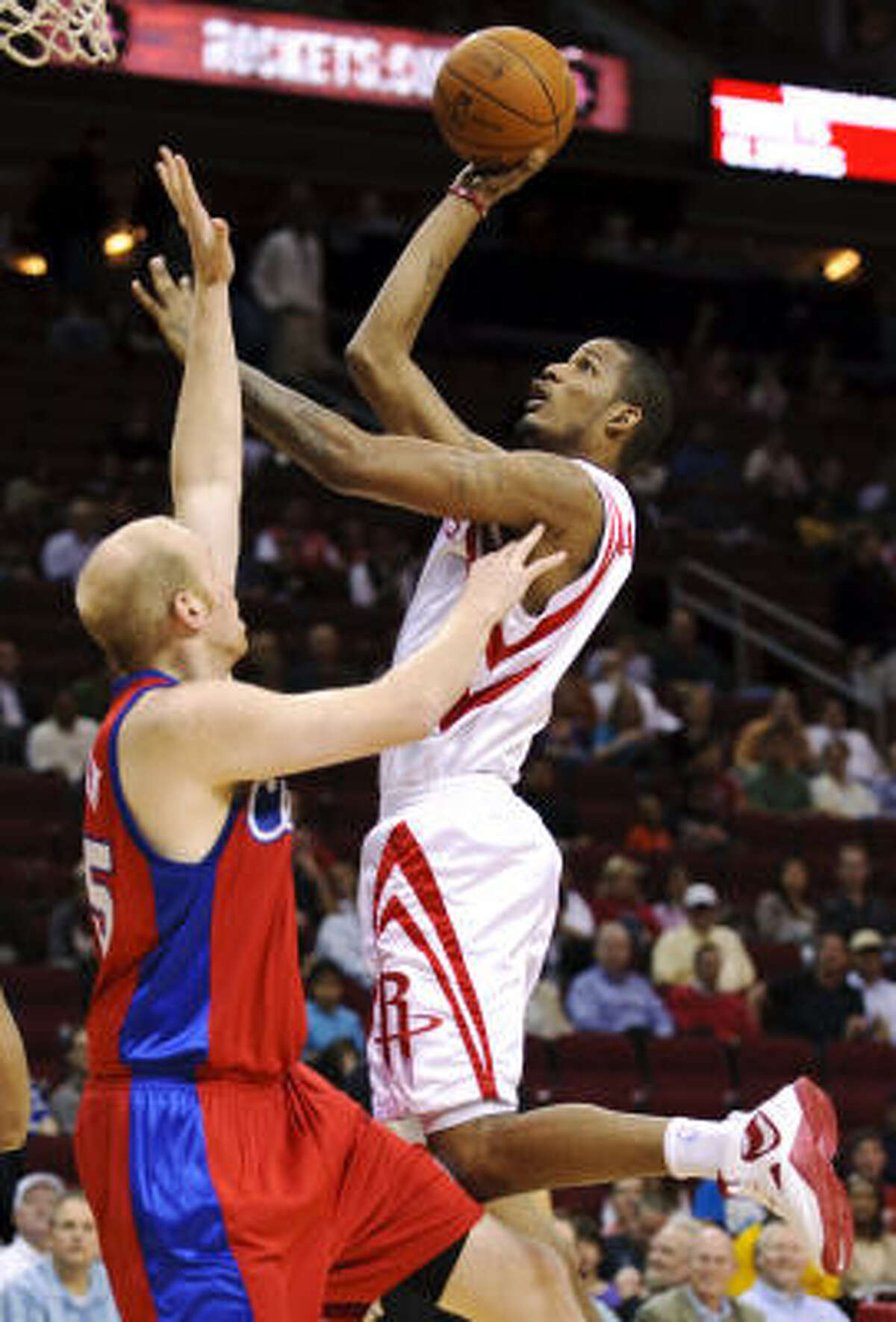 Rockets' Trevor Ariza, right, shoots over Los Angeles Clippers' Chris Kaman. Ariza finished with 18 points, eight rebounds and eight assists.