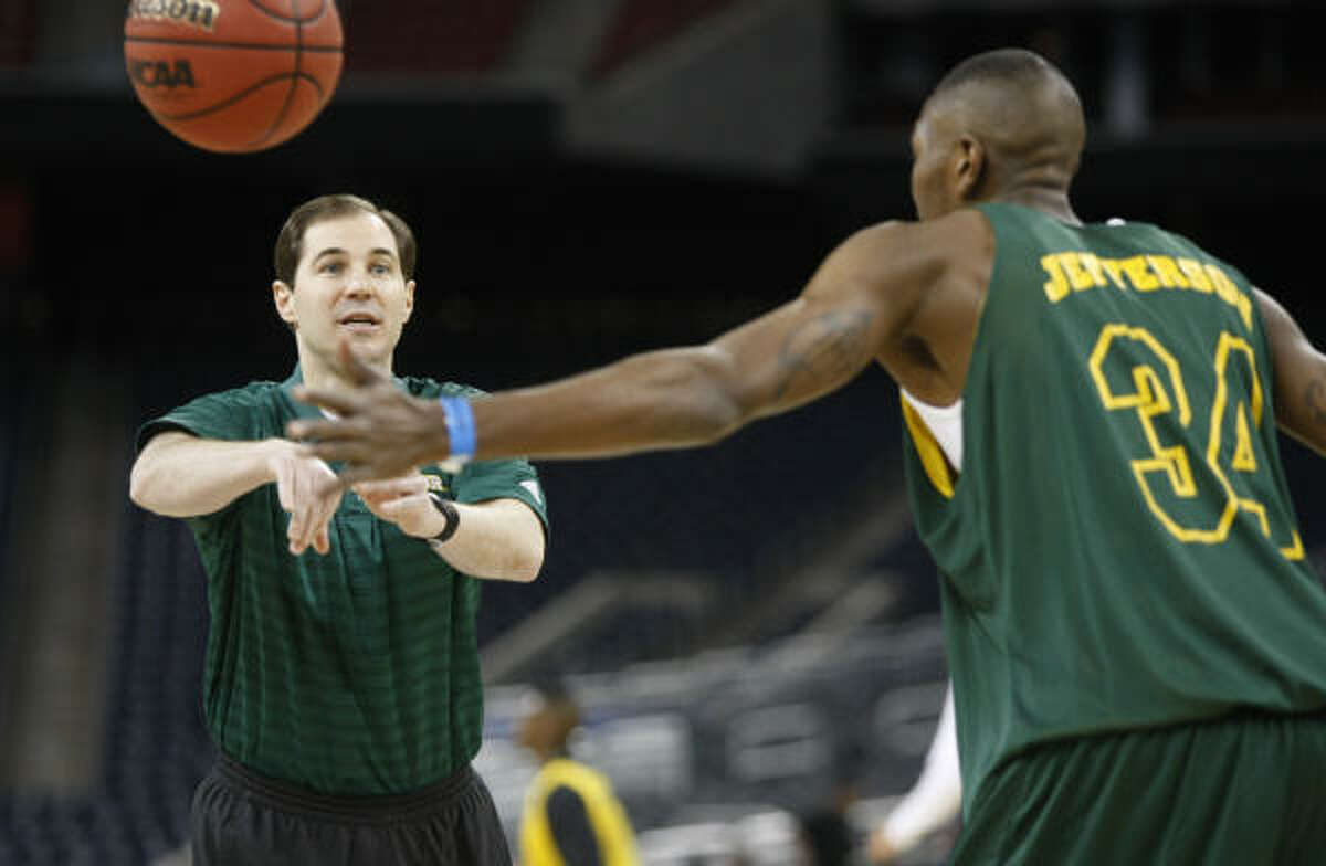 Baylor coach Scott Drew throws the ball to forward Cory Jefferson during practice at Reliant Stadium. The Bears face Saint Mary's in the South Regional semifinals on Friday.