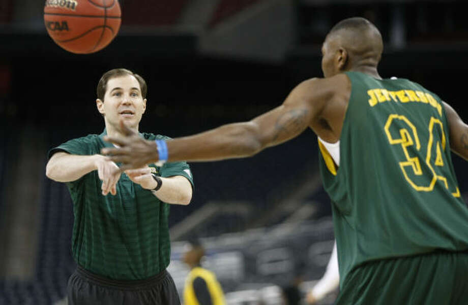 Baylor coach Scott Drew throws the ball to forward Cory Jefferson during practice at Reliant Stadium. The Bears face Saint Mary's in the South Regional semifinals on Friday. Photo: Nick De La Torre, Chronicle