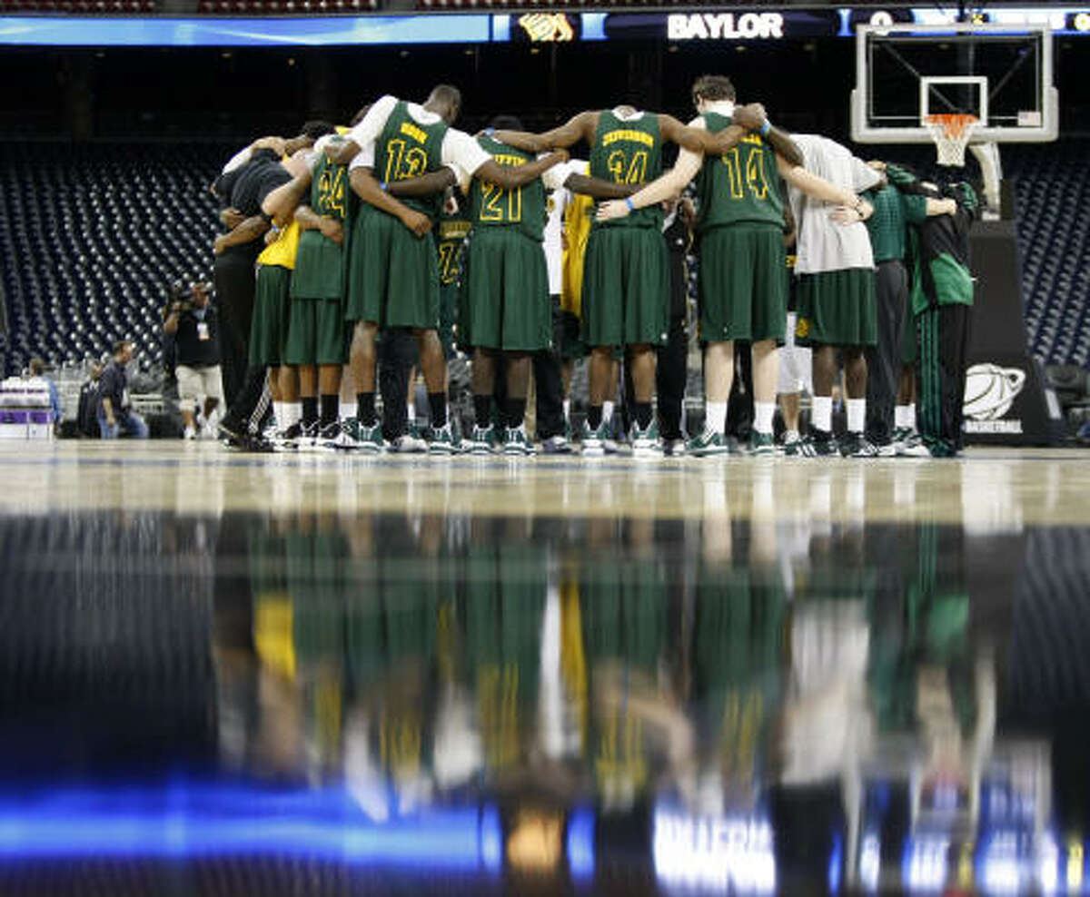 Baylor players huddle before practice Thursday at Reliant Stadium.